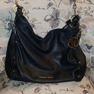 Michael Kors purse in black and gold